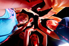 Glad teens. Joyful teens enjoying themselves in night club while dancing Royalty Free Stock Photography