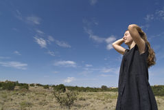 Glad To Be Alive. Pretty young woman/teenage girl greets the sunny high-desert morning royalty free stock images