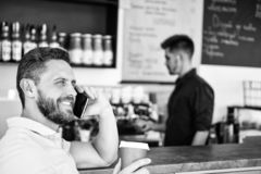Glad to hear you. Coffee take away option for busy people. Man mobile conversation cafe barista background. Drink coffee. While waiting. Man smartphone order stock image