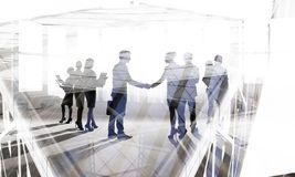 Glad to meet you partner. Silhouettes of business people shaking hands to greet each other stock photo