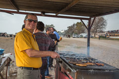 Glad tourist at the grill Stock Images