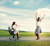 Glad woman and angry woman Stock Photography