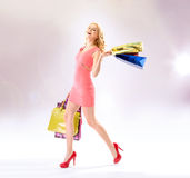 Glad woman doing the shopping Royalty Free Stock Image