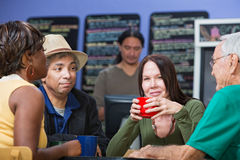 Glad Woman with Friends in Cafe Stock Image