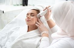 Glad woman getting treatment of skin stock photo