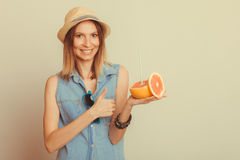 Glad woman in hat with sunglasses and grapefruit Royalty Free Stock Photo
