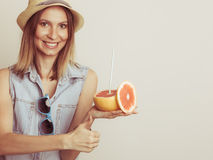 Glad woman in hat with sunglasses and grapefruit Stock Photography