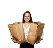 Glad woman holding paper bags over white Stock Photography