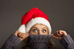 Glad Woman In Santa Hat. Studio Shot Royalty Free Stock Images