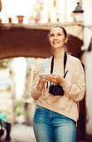 Glad woman looking for the map in the phone Stock Image