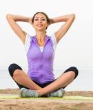 Glad woman practise yoga cross-legged Royalty Free Stock Image