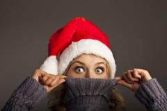 Glad woman in santa hat. studio shot Royalty Free Stock Images