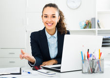Glad woman working at laptop Stock Photography
