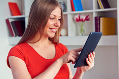 Woman using the tablet pc Stock Photo