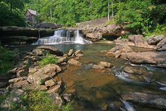Glade Creek Waterfall. A small waterfall on Glade Creek with a grist mill in the background Stock Photography