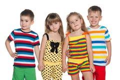 Glade fyra barn Arkivbilder