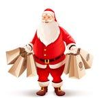 Glade Santa Claus med shoppingpåsar köper gåvor och sötsaker för jul Arkivfoton