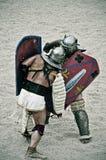 Gladiadores en la arena del anfiteatro romano de Tarragona, Spai Fotos de archivo libres de regalías