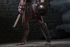 Gladiateur avec le bouclier et la hache Image stock
