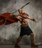 Gladiateur blessé avec la lance photographie stock libre de droits