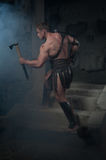 Gladiator in armour standing on steps of ancient Stock Photography