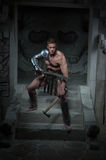 Gladiator in armour standing on steps of ancient Stock Image