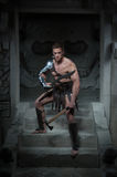 Gladiator in armour standing on steps of ancient Royalty Free Stock Photos