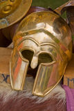 Gladiator helmet. A gladiator helmet resting on a table with animal skins Stock Photos