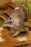 Gladiator helmet. A gladiator helmet resting on a table with animal skins Stock Images