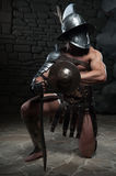 Gladiator in helmet and armour holding sword Royalty Free Stock Image