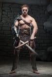 Gladiator med två svärd Arkivfoton