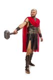 Gladiator met hamer op wit wordt geïsoleerd dat Stock Foto's