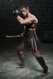 Gladiator mit Schild und Axt Stockbild