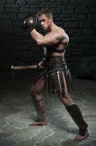 Gladiator with shield and axe Stock Image