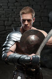 Gladiator with shield and sword Royalty Free Stock Photography