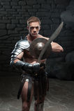 Gladiator with shield and sword Royalty Free Stock Photos
