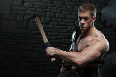 Gladiator with sword and axe Stock Images