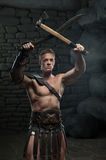 Gladiator with sword and axe Royalty Free Stock Images