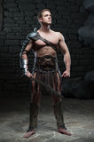 Gladiator with sword posing Royalty Free Stock Images