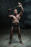 Gladiator with sword posing Royalty Free Stock Image