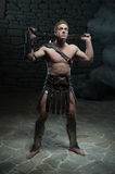 Gladiator with sword posing Stock Photography