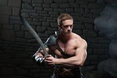 Gladiator with sword posing Stock Photos