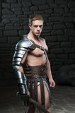 Gladiator with sword posing Royalty Free Stock Photography