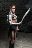 Gladiator with sword posing Stock Photos