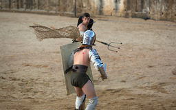 Gladiator throws the net Royalty Free Stock Images