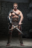 Gladiator with two swords Stock Photos