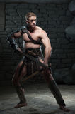 Gladiator with two swords Royalty Free Stock Images