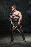 Gladiator with two swords Royalty Free Stock Photography