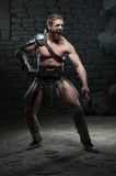 Gladiator with two swords Royalty Free Stock Image