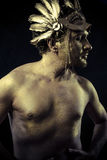 Gladiator, Warrior with helmet and sword with his body painted g Royalty Free Stock Photos